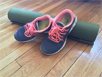 running shoes and yoga mat